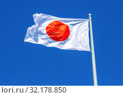 Flag of Japan waving in the wind against the sky. Стоковое фото, фотограф FotograFF / Фотобанк Лори