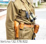 Купить «Vintage leather holster, binoculars and other ammunition on the belt», фото № 32178922, снято 6 октября 2018 г. (c) FotograFF / Фотобанк Лори