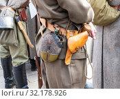 Купить «Vintage leather holster and other ammunition on the belt», фото № 32178926, снято 6 октября 2018 г. (c) FotograFF / Фотобанк Лори