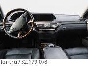 Купить «Car dashboard and steering wheel», фото № 32179078, снято 12 сентября 2019 г. (c) Дмитрий Бачтуб / Фотобанк Лори