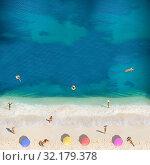 Купить «People swim, sunbath on the beach view from above», фото № 32179378, снято 22 октября 2019 г. (c) Сергей Новиков / Фотобанк Лори
