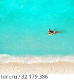 Купить «Woman swim with color buoy in the water on beach», фото № 32179386, снято 21 октября 2019 г. (c) Сергей Новиков / Фотобанк Лори