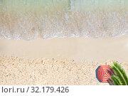 Купить «Palm tree leaves, umbrella, beach edge with wave», фото № 32179426, снято 15 октября 2019 г. (c) Сергей Новиков / Фотобанк Лори