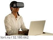 Купить «Young businesswoman using a VR headset», фото № 32180662, снято 24 октября 2018 г. (c) Wavebreak Media / Фотобанк Лори