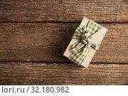 Купить «Simple wrapped gift on wooden table», фото № 32180982, снято 13 августа 2019 г. (c) Wavebreak Media / Фотобанк Лори