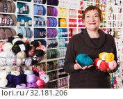 Купить «Woman in needlework shop», фото № 32181206, снято 10 мая 2017 г. (c) Яков Филимонов / Фотобанк Лори