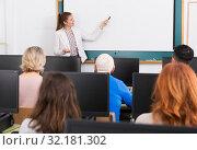 Купить «Young female trainer giving presentation», фото № 32181302, снято 20 февраля 2019 г. (c) Яков Филимонов / Фотобанк Лори