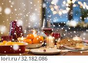 Купить «glass of red wine and food on christmas table», фото № 32182086, снято 17 декабря 2017 г. (c) Syda Productions / Фотобанк Лори