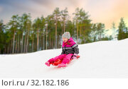 Купить «happy little girl sliding down on sled in winter», фото № 32182186, снято 10 февраля 2018 г. (c) Syda Productions / Фотобанк Лори