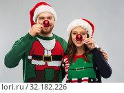 Купить «happy couple in christmas sweaters and santa hats», фото № 32182226, снято 9 декабря 2018 г. (c) Syda Productions / Фотобанк Лори