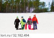 Купить «happy little kids with sleds in winter», фото № 32182494, снято 10 февраля 2018 г. (c) Syda Productions / Фотобанк Лори