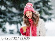 Купить «happy teenage girl with coffee in winter park», фото № 32182630, снято 29 января 2019 г. (c) Syda Productions / Фотобанк Лори