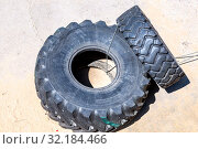 Two heavy tires from a truck for sport exercises (2019 год). Редакционное фото, фотограф FotograFF / Фотобанк Лори