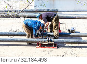 Купить «Workers produce work of laying plastic water pipes», фото № 32184498, снято 6 мая 2018 г. (c) FotograFF / Фотобанк Лори