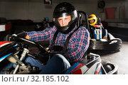 Купить «Man and his friends competing on racing cars», фото № 32185102, снято 19 октября 2019 г. (c) Яков Филимонов / Фотобанк Лори