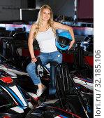 Купить «Woman standing near go-kart cars», фото № 32185106, снято 22 октября 2019 г. (c) Яков Филимонов / Фотобанк Лори