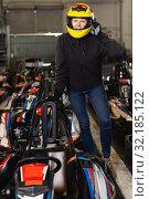 Купить «female go-cart racer posing at cart circuit», фото № 32185122, снято 18 марта 2019 г. (c) Яков Филимонов / Фотобанк Лори