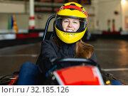 Купить «female go-cart racer posing at cart circuit», фото № 32185126, снято 18 марта 2019 г. (c) Яков Филимонов / Фотобанк Лори
