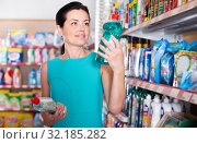 Купить «Pretty woman want to buying cleaners in bottle», фото № 32185282, снято 6 июня 2017 г. (c) Яков Филимонов / Фотобанк Лори