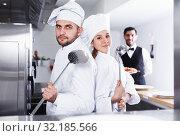Купить «Chefs in fish restaurant kitchen», фото № 32185566, снято 26 января 2018 г. (c) Яков Филимонов / Фотобанк Лори