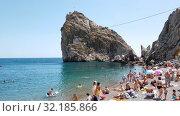 Купить «Simeiz, Crimea - July 1, 2019. Beach near Diva Rock, showplace», видеоролик № 32185866, снято 1 июля 2019 г. (c) Володина Ольга / Фотобанк Лори