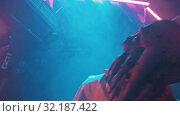 Купить «An alien with tentacles in the lower face walking on the secret laboratory in worker clothes - looking in the camera», видеоролик № 32187422, снято 20 октября 2019 г. (c) Константин Шишкин / Фотобанк Лори