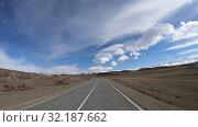 Купить «Driving along mountain road Chuysky Tract along Kurai Ridge on Altai at Spring season», видеоролик № 32187662, снято 16 июля 2019 г. (c) Serg Zastavkin / Фотобанк Лори