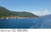 Купить «Fragment of the Bay of Kotor with houses on shore, Montenegro», видеоролик № 32188094, снято 12 июля 2019 г. (c) Володина Ольга / Фотобанк Лори