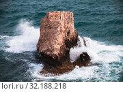 Купить «Coastal rocky islet with big waves», фото № 32188218, снято 11 июня 2018 г. (c) EugeneSergeev / Фотобанк Лори