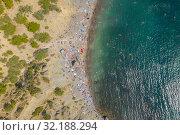 Купить «Aerial view of crowded colorful paradise beach on Black Sea, Crimea», фото № 32188294, снято 10 сентября 2019 г. (c) Кирилл Трифонов / Фотобанк Лори