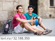 Купить «glad male fans are drinking beer and talking about football outdoor in Barcelona», фото № 32188350, снято 19 августа 2017 г. (c) Яков Филимонов / Фотобанк Лори