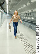 Купить «Attractive woman waiting for the subway train», фото № 32188610, снято 31 марта 2019 г. (c) Яков Филимонов / Фотобанк Лори