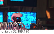 Купить «Secret Alien Research Lab - electric current generating machine on the foreground - a man in metal glove showing the control of little lightnings - technology exhibition», видеоролик № 32189190, снято 20 октября 2019 г. (c) Константин Шишкин / Фотобанк Лори