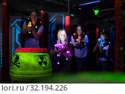 Kids with parents during lasertag game. Стоковое фото, фотограф Яков Филимонов / Фотобанк Лори