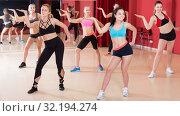Купить «Smiling active females exercising dance moves», фото № 32194274, снято 31 мая 2017 г. (c) Яков Филимонов / Фотобанк Лори