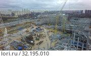 Купить «Construction site with steel structures in Moscow, aerial view», видеоролик № 32195010, снято 28 марта 2020 г. (c) Данил Руденко / Фотобанк Лори