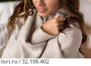 Купить «close up of young woman wrapped in blanket at home», фото № 32198402, снято 15 октября 2016 г. (c) Syda Productions / Фотобанк Лори