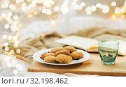 Купить «oatmeal cookies and candle in holder at home», фото № 32198462, снято 15 ноября 2017 г. (c) Syda Productions / Фотобанк Лори