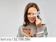 Купить «woman in christmas sweater with reindeer pattern», фото № 32198586, снято 9 декабря 2018 г. (c) Syda Productions / Фотобанк Лори