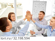 Купить «happy business team making high five at office», фото № 32198594, снято 5 апреля 2014 г. (c) Syda Productions / Фотобанк Лори