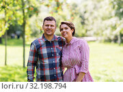 Купить «happy couple in summer park», фото № 32198794, снято 18 августа 2019 г. (c) Syda Productions / Фотобанк Лори