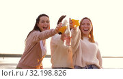 young women toasting non alcoholic drinks on beach. Стоковое видео, видеограф Syda Productions / Фотобанк Лори