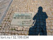 "Купить «The inscription on the stone sidewalk: ""... a new face appeared on the embankment: a lady with a dog"" A.P. Chekhov ""A lady with a dog"".», фото № 32199034, снято 3 сентября 2019 г. (c) Валерий Смирнов / Фотобанк Лори"