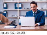 Купить «Young handsome businessman working in the office», фото № 32199958, снято 16 апреля 2019 г. (c) Elnur / Фотобанк Лори