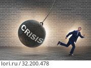 Купить «Businessman in crisis management concept», фото № 32200478, снято 20 февраля 2020 г. (c) Elnur / Фотобанк Лори