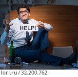 Купить «Employee asking for help and drinking under stress and despair», фото № 32200762, снято 14 октября 2017 г. (c) Elnur / Фотобанк Лори