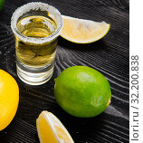 Купить «Tequila drink served in glasses with lime and salt», фото № 32200838, снято 18 сентября 2017 г. (c) Elnur / Фотобанк Лори