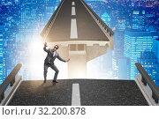 Купить «Young businessman in uncertainty concept with bridge», фото № 32200878, снято 28 января 2020 г. (c) Elnur / Фотобанк Лори