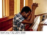 Prayer in a side chapel of Ouagadougou's catholic cathedral, Burkina Faso. Стоковое фото, фотограф Philippe Lissac / Godong / age Fotostock / Фотобанк Лори