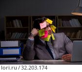 Купить «Businessman staying late to sort out priorities», фото № 32203174, снято 25 января 2017 г. (c) Elnur / Фотобанк Лори
